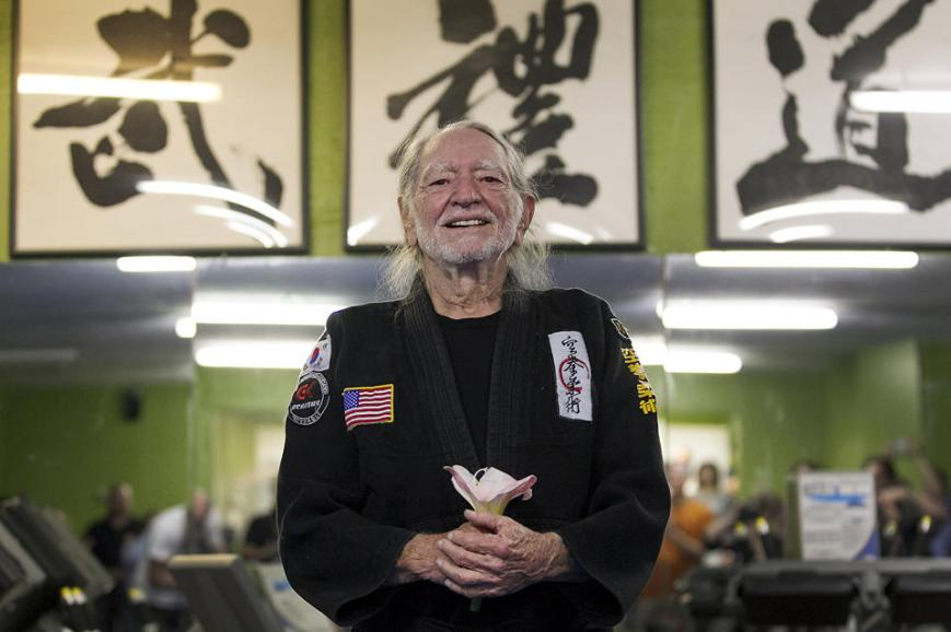 Willie Nelson ears his 5th degree black belt (photo courtesy of Austin American-Statesman, Ralph Barrera)