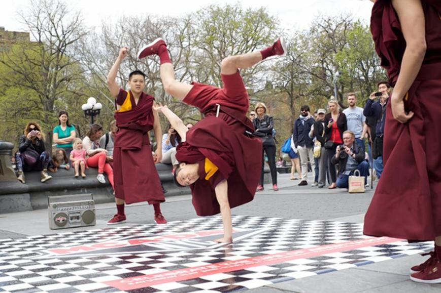 Buddhist monks celebrate  MCA Day in New York City with an amazing breakdancing demo! (photo: courtesy of nydailynews.com)
