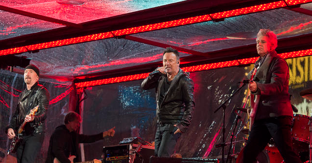 Bruce Springsteen and Chris Martin perform with U2 band at World AIDs Day concert in Times Square.